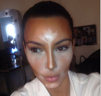 Kim Kardashian showing where to apply highlight