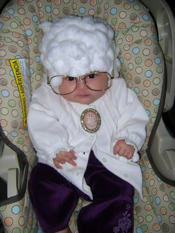 Baby dressed as Sofia from The Golden Girls